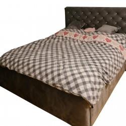 Łóżko tapicerowane z dużymi...